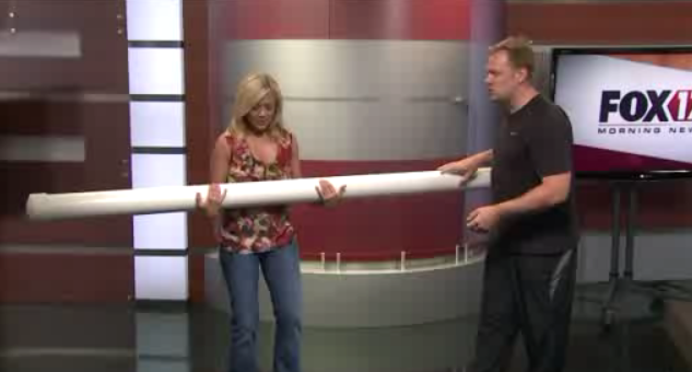 Fox 17 Morning Show host Sarah Brodhead wrestles with the slosh pipe
